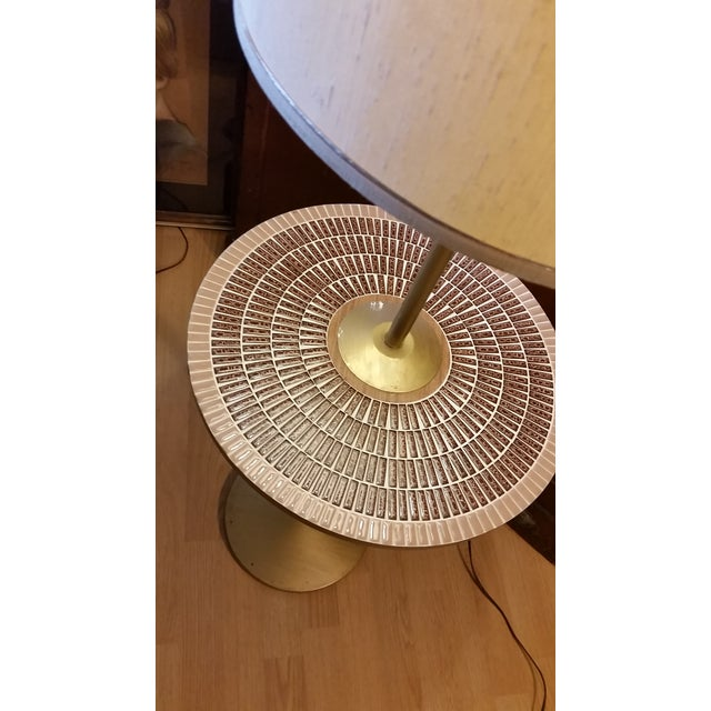 Here's a very nice 1960s to 70s floor lamp that features a mosaic table and a brass base and pole. It also has the...