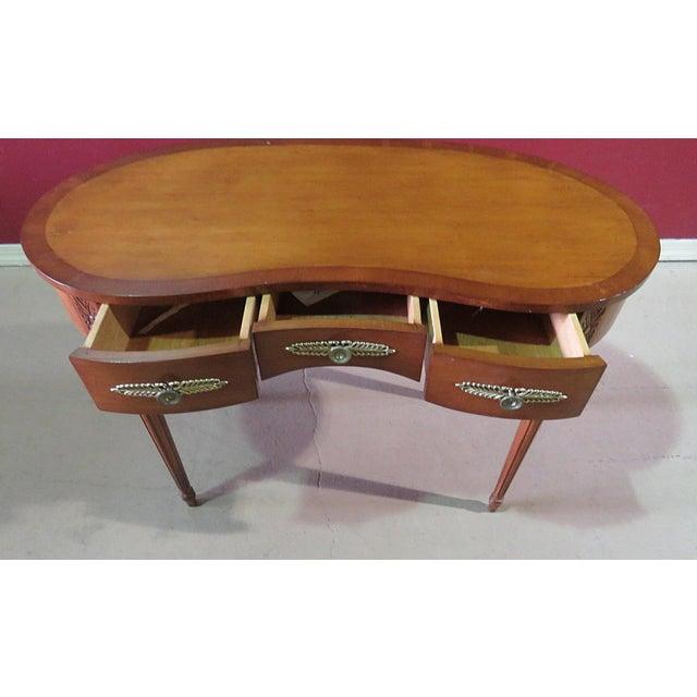 Louis XVI style kidney shaped 3 drawer inlaid writing desk.