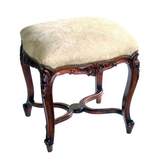 An Elegant French Regence Style Carved Walnut Serpentine-Shaped Stool With Cut-Suede Upholstery For Sale