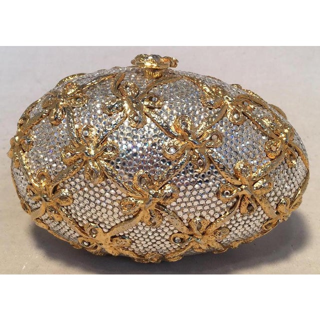 Judith Leiber Swarovski Crystal Clear and Gold Faberge Egg Minaudiere in excellent condition. Clear swarovski crystals...