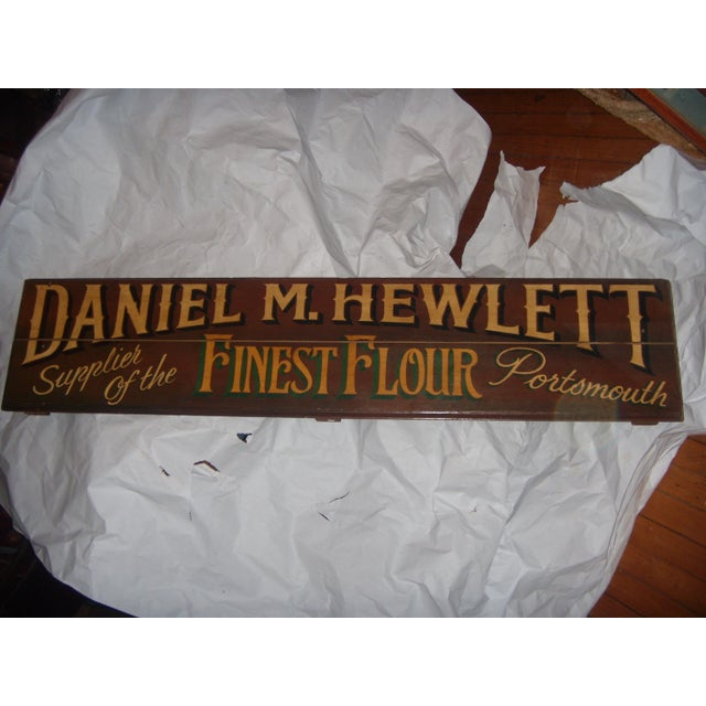 "A very nice English shop sign painted on wood, reading ""Daniel Hewlett Finest Flour."" A great kitchen decor item."