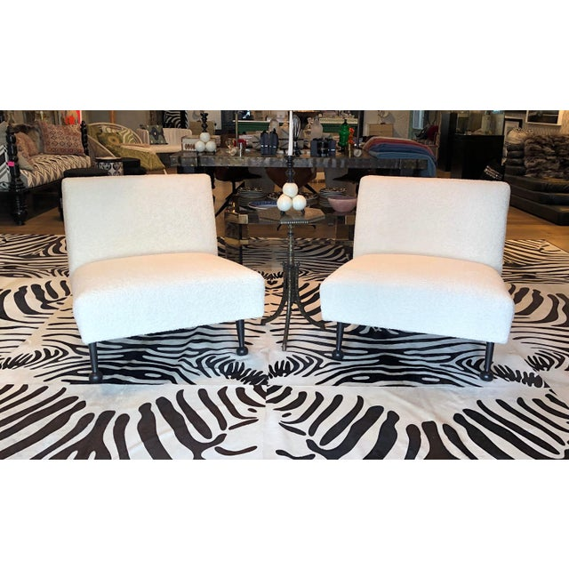 Garbo Slip Chair by Martyn Lawrence Bullard. Ebonized wood frame and leg, upholstered in a white Wool Boucle.