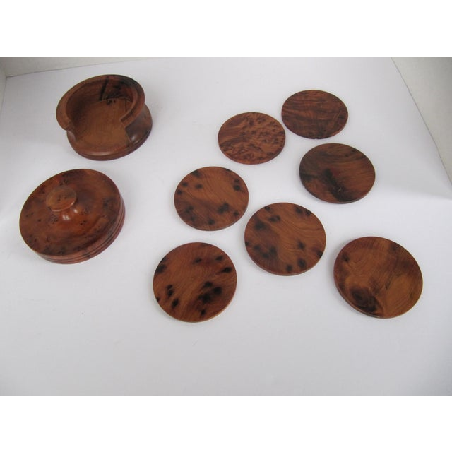 """Gorgeous wood box holding 7 wood coasters. This classic piece would look great in any room. Coasters measure, 3""""Diam."""