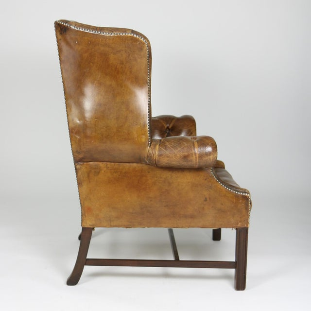 An Elegant Brown Tufted Leather and Mahogany Wing Chair with Tight Seat; English Circa 1860. For Sale - Image 4 of 13