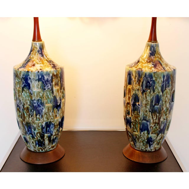 For your consideration is a phenomenal pair of blue lava drip glaze table lamps, with their original shades and finials....