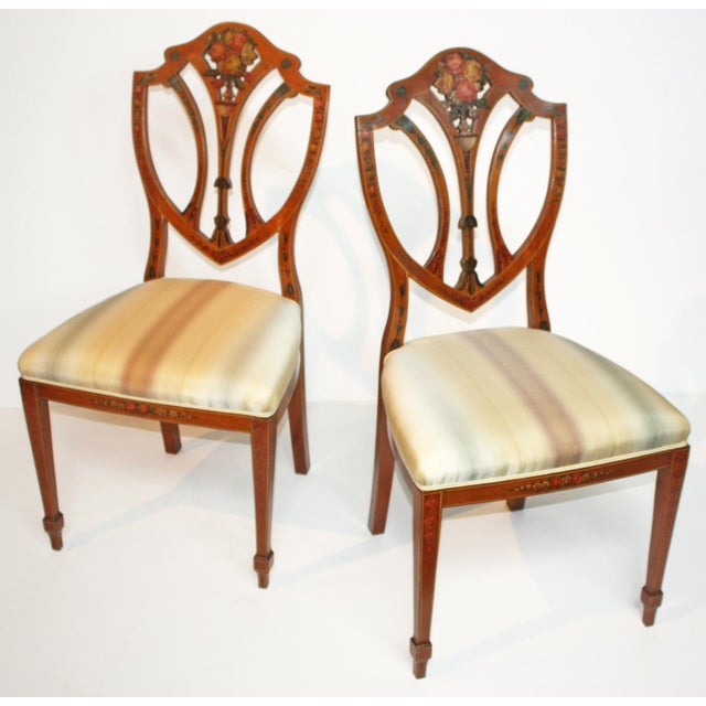 Pair of Satinwood Revival / Edwardian shield back chairs in the Georgian style, their back splats and crest rail decorated...