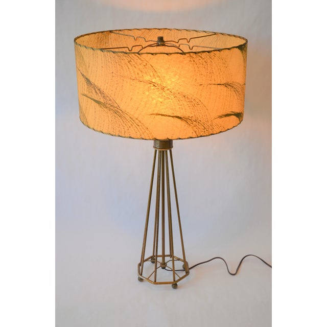 Amazing Mid-Century Atomic Era 1950s wire frame lamp with laced fiberglass shade. This large scale lamp is in beautiful...