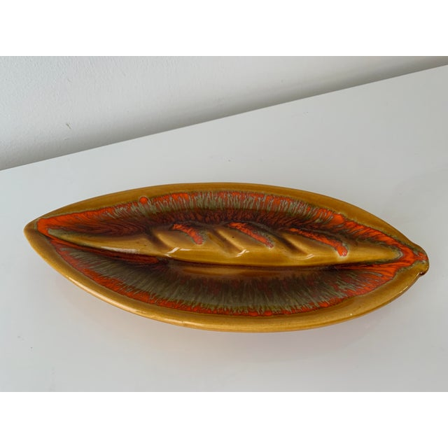 Mid-Century, retro leaf shape drip glaze pottery ashtray. Circa 1960's with gloss drip glaze in random tones of...