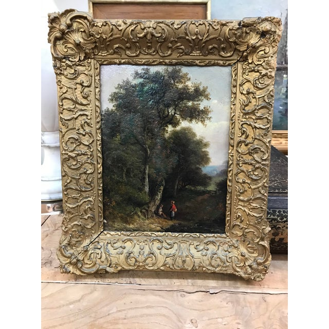 Small 19th Century European pastoral with figures on a path. Oil on board. Original frame with some losses.