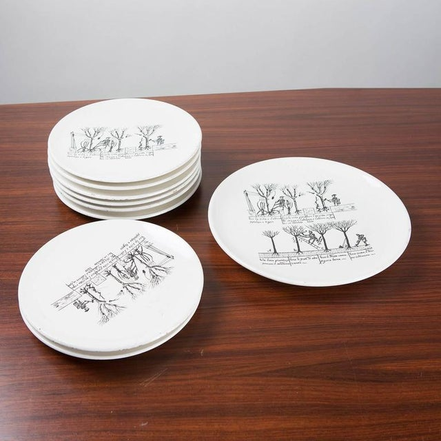 Rare set of 9 ceramic plates by Enzo Bioli for Il Picchio. 8 dining plates and another bigger piece. Beautiful drawings...