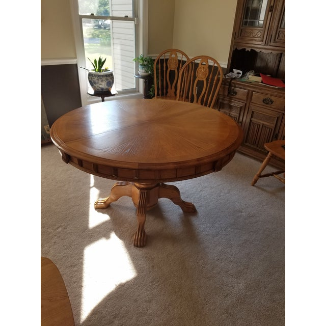 This is a sturdy solid honey oak dining table with intricate details that can fit in with nice country decor. There are...