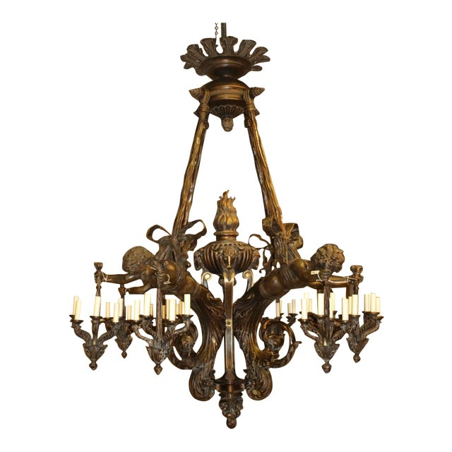 Antique Chandelier. Wood and bronze chandelier with cherubs For Sale