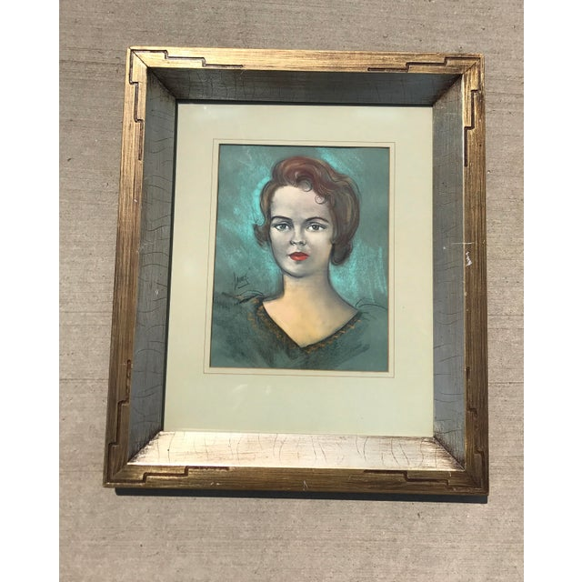 Vintage chalk drawing portrait of a female with blues and browns in a beautiful brushed silver brushed engraved frame....