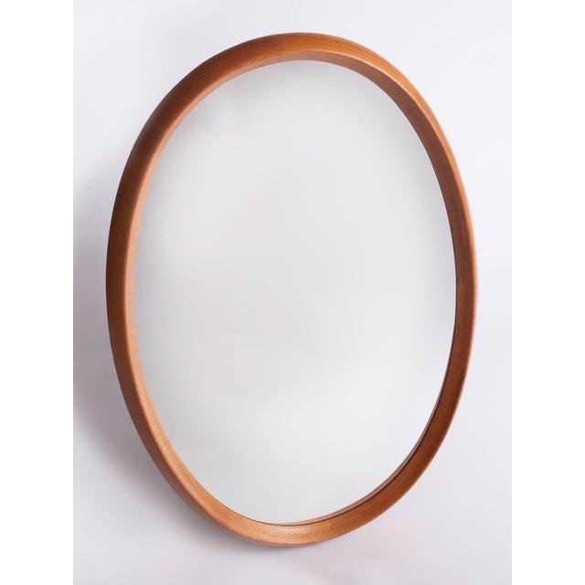 A monumental, finely crafted Scandinavian Modern oval mirror with a geometric zipper motif by Pedersen & Hansen. In...