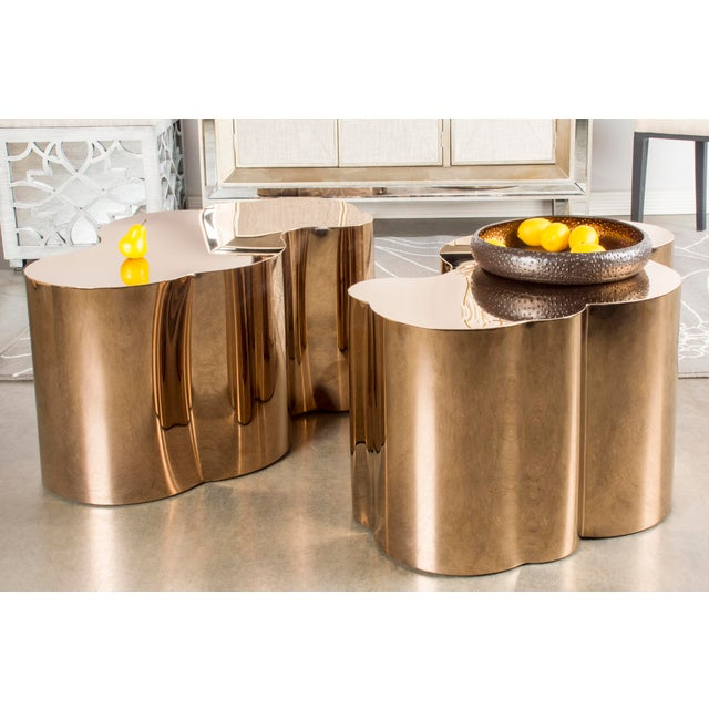 Free form stainless steel coffee table is sure a statements piece. This is a new, unused table. Create an ambience of...