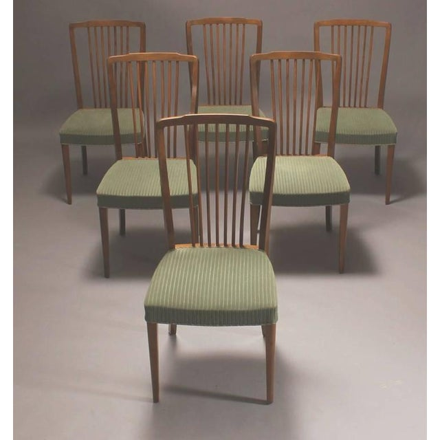 Set of six Danish early 1950s-1960s spindle back dining chairs of stained beech wood.