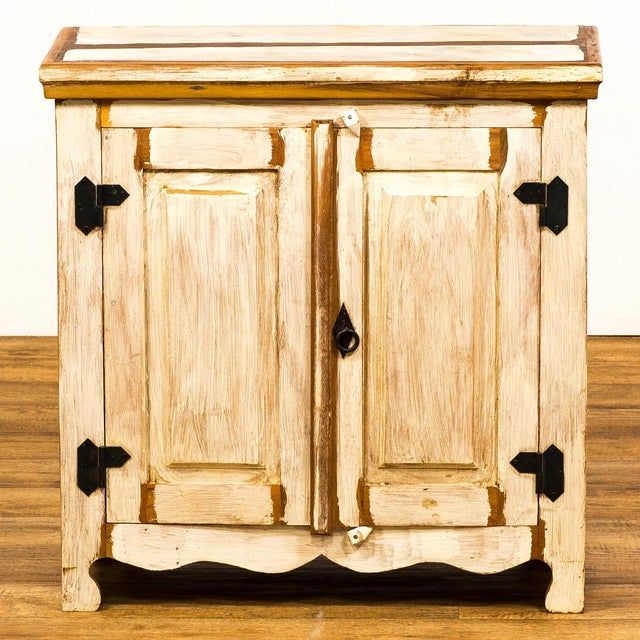 This original cabinet combines storage efficiency with eco-friendly wood. Standing off the floor on short legs, this...