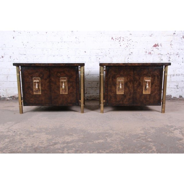 A gorgeous pair of mid-century modern Hollywood Regency nightstands or side tables By Bernhard Rohne for Mastercraft USA,...
