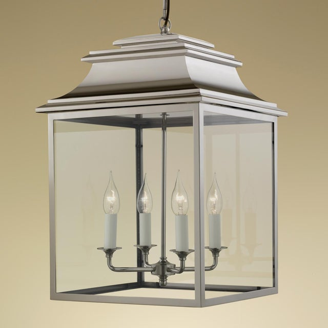 Polished nickel lantern with 4 lamps made in nickel plated brass with clear glass. Clear LED or halogen lamps recommended....