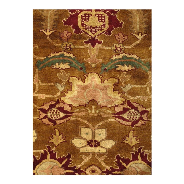 An Indian Agra rug that is hand-knotted and exhibits a fine weave. It is 100% lamb's wool and is from India.