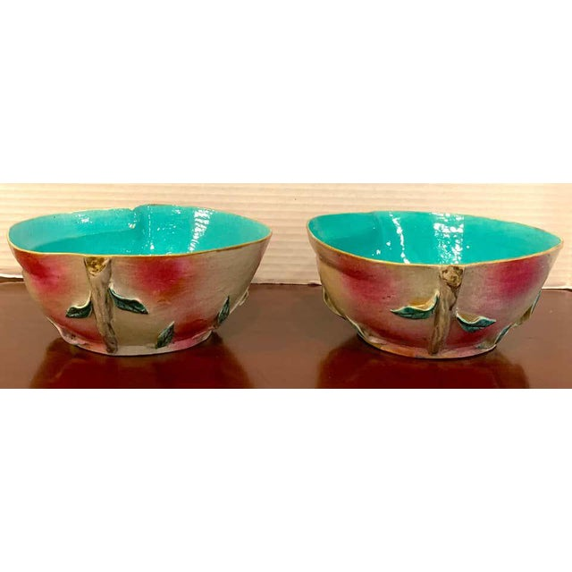 Pair of Chinese export famille rose altar fruit peach bowls, each one realistically modeled and painted.
