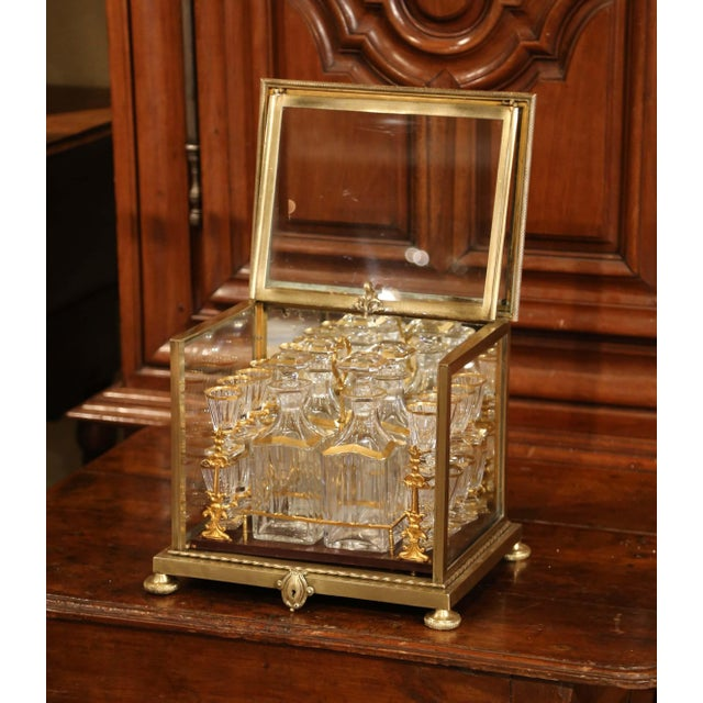 This elegant antique cave à liqueur was created in France, circa 1860. Sited on round feet, the rectangular liquor box has...