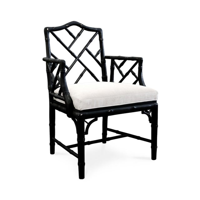 Listed is a fabulous, pair of black lacquered faux bamboo Chinese Chippendale armchairs with white linen upholstered...