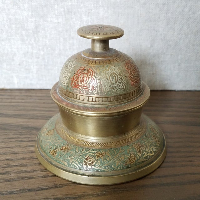 Vintage solid brass elephant bell with intricately, hand etched, floral and vine pattern. The top is the bell portion and...
