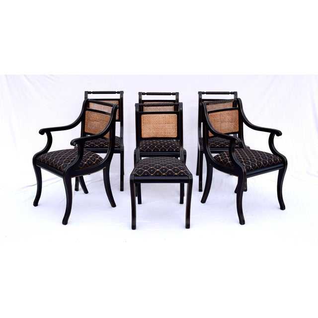 Set of eight English Regency style dining chairs feature solid lacquered wood construction with rope twist horizontal...