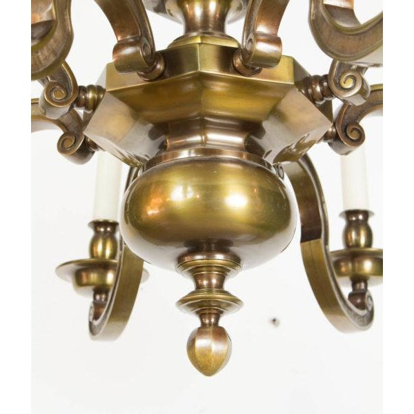 Eight Light Chandelier, solid cast brass with substantial arms. Early 20th Century. Completely restored with a dark...