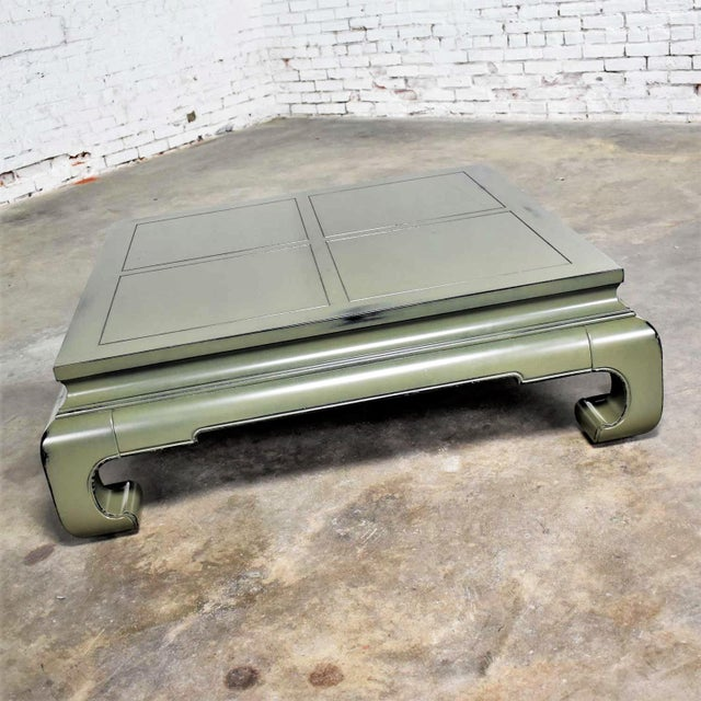 Handsome monumental in size square chunky Ming style coffee table. Recently lacquered a deep sage green with a faux...