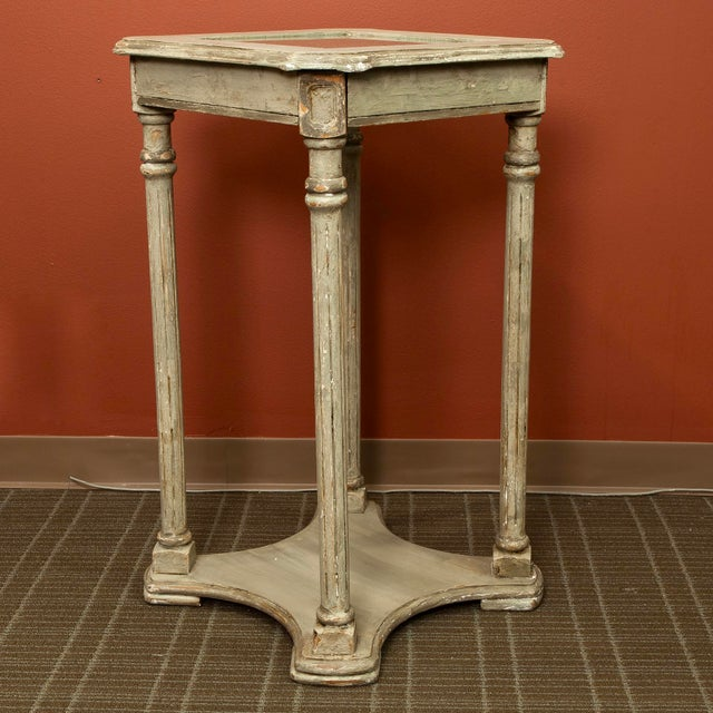 Turn of the century French painted side table or sculpture stand has a pale taupe painted finish, caned top with glass...