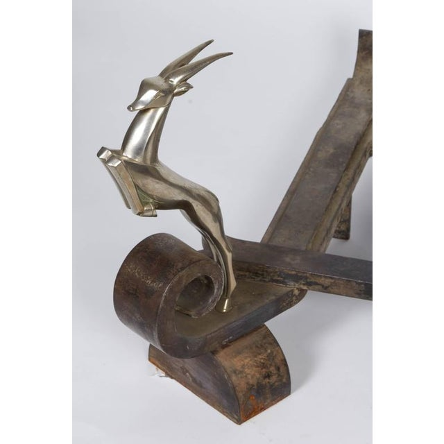 Raymond Subes firedogs of wrought iron decorated with two antelopes.