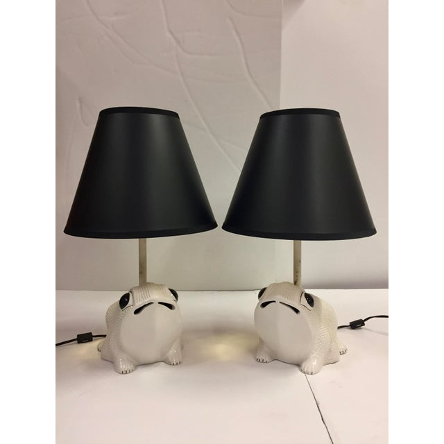 Pair marked made in Italy vintage white ceramic Hobnail frog lamps. New black shades with gold interior. These lamps are...