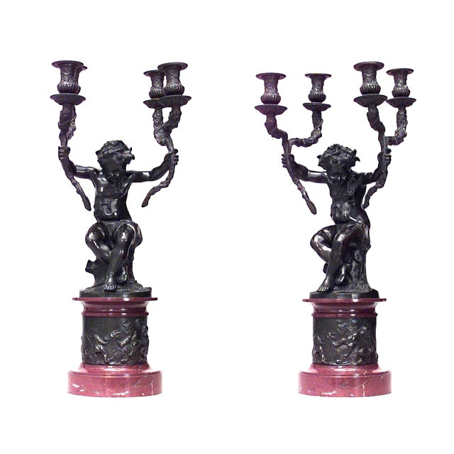 Pair of French Louis XVI Style Cupids Holding Two-Arm Candelabra For Sale