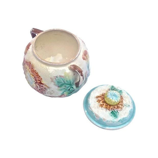 Antique 19th-century French majolica dahlia floral lidded sugar bowl with vine-style handles. Floral and leaf design in...