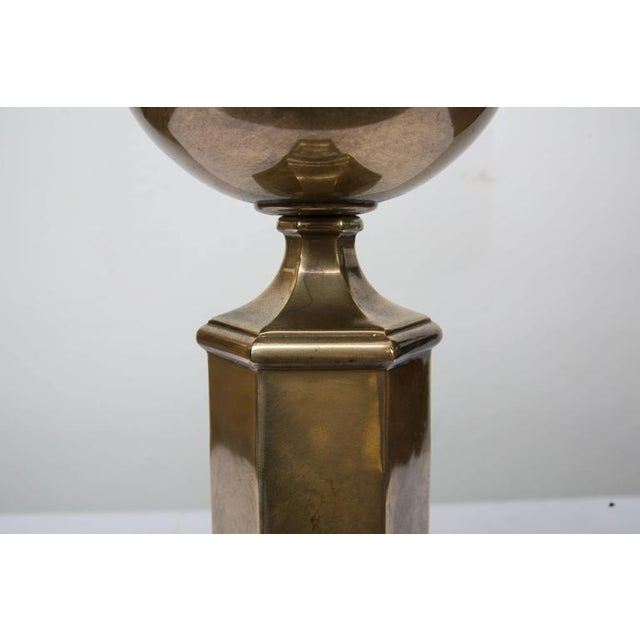 This Classic pair of hexagonal brass lamps has an antique finish and wood base offering a perfect accent for a traditional...