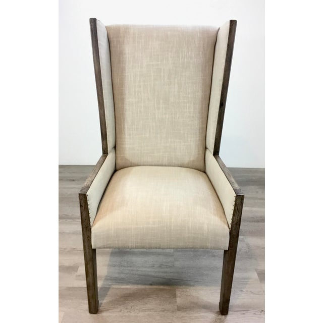 Original Retail $1250, stylish Transitional Carved Wood Linen Wingback Chair, gray wood frame upholstered in an tan...
