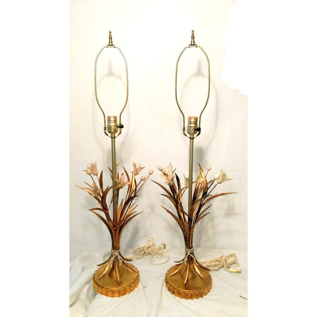 Offered is a pair of vintage Italian tole style table lamps made by Leviton. The lamps are a bouquet of gilded brass stems...