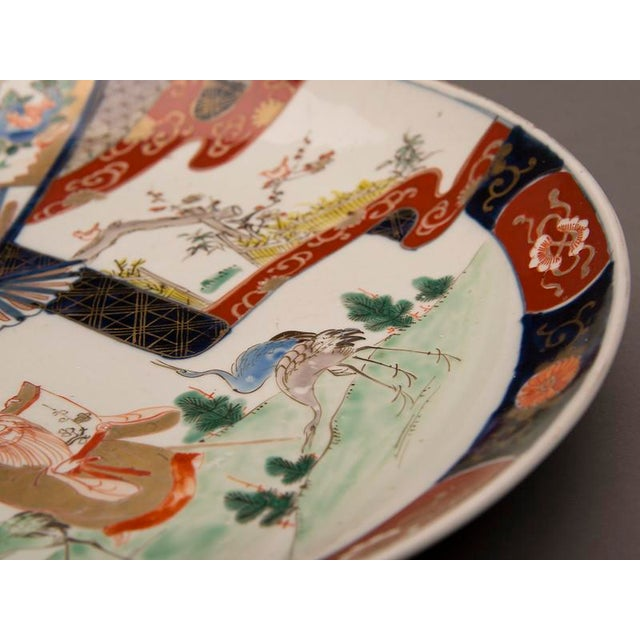 An Imari charger from Arita, Japan c. 1875 featuring a scholar reading a scroll in a landscape surrounded by three cranes For Sale In Houston - Image 6 of 7