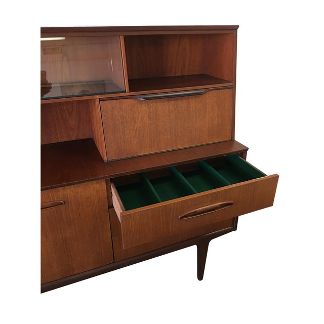 Looking for a small Danish buffet with storage? Here's a 60's Danish cutie in teak and afromosia (African mahogany) with a...