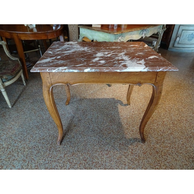 19th Century French walnut side table with red and white marble top. Curved tapered legs and curved apron all around the...