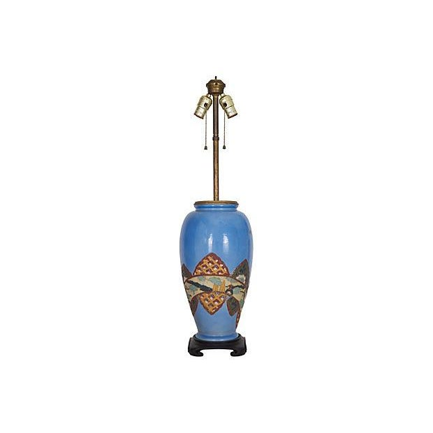 Exceptional Asian motif lamp made from an old antique Chinese blue pottery vase with raised relief decoration accented...