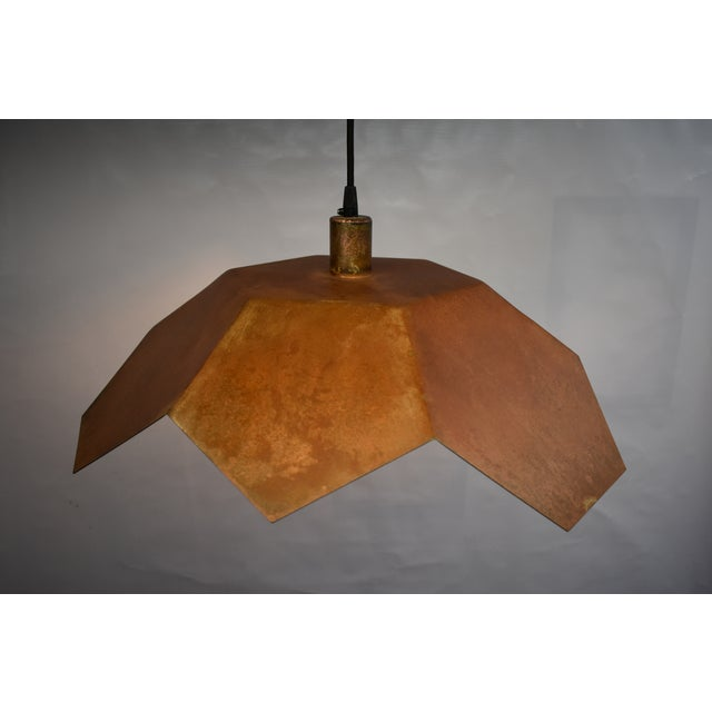 Geometrically inspired ceiling pendant light designed and fabricated by Oblik studio design in Brooklyn New York. Tan...