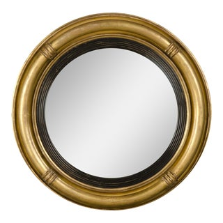 A Regency period gold leaf circular frame enclosing the original convex mirror glass from England c.1830 (22″dia.)