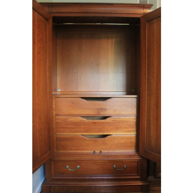 Really beautiful cherry wood armoire by Ethan Allen. We are clearing out space in our home. It has a bar for clothing but...