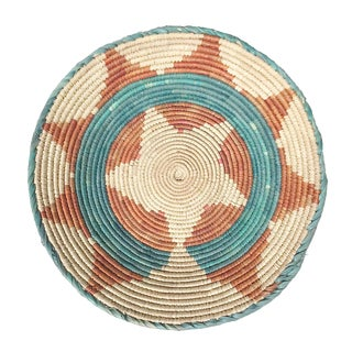 1970's African Flat Weave Coil Basket With Orange and Teal Star and Sun Pattern For Sale