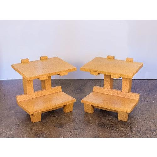 Sold as a pair. Post-modern pair of cork side tables by Kevin Walz for KorQinc. Cantilever form is geometrically striking...