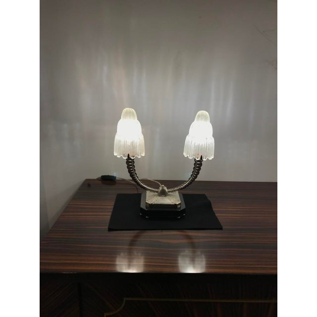 A stunning pair of French Art Deco table lamps created in the 1930s by Marius Ernest Sabino, (1878-1961). The shades are...