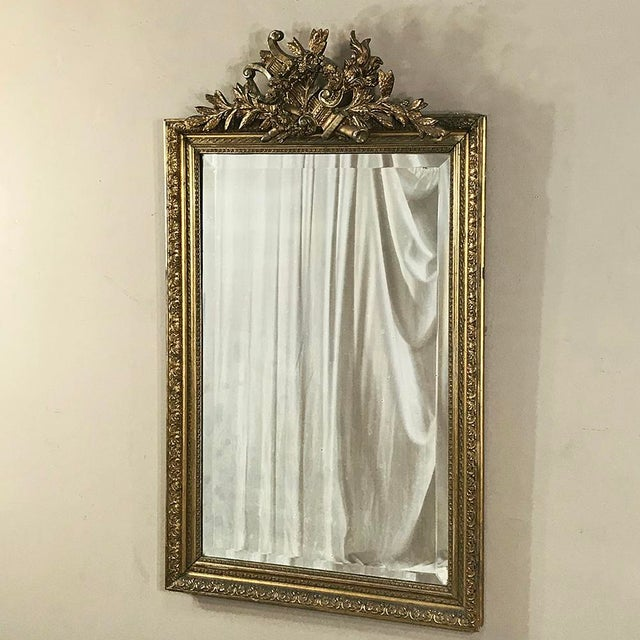 19th Century French Louis XVI Gilded Mirror is an elegant way to decorate your room, as well as bounce ambient light off...